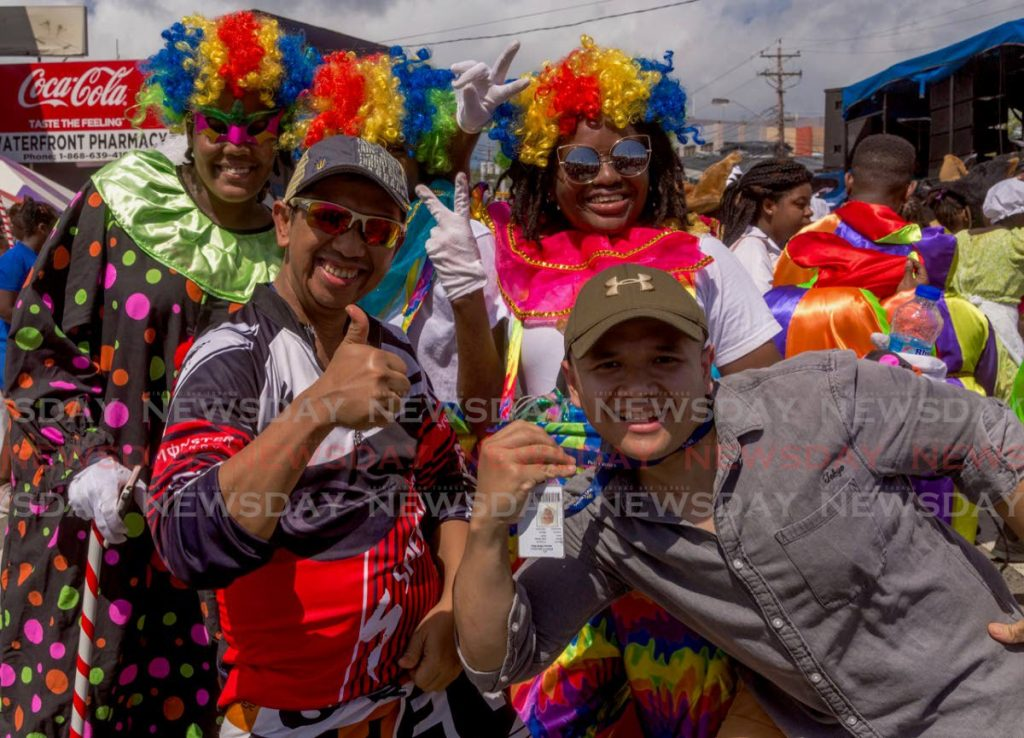 Visitors have fun at  the launch of Tobago Carnival in Scarborough on Friday. PHOTOS BY DAVID REID  - DAVID REID