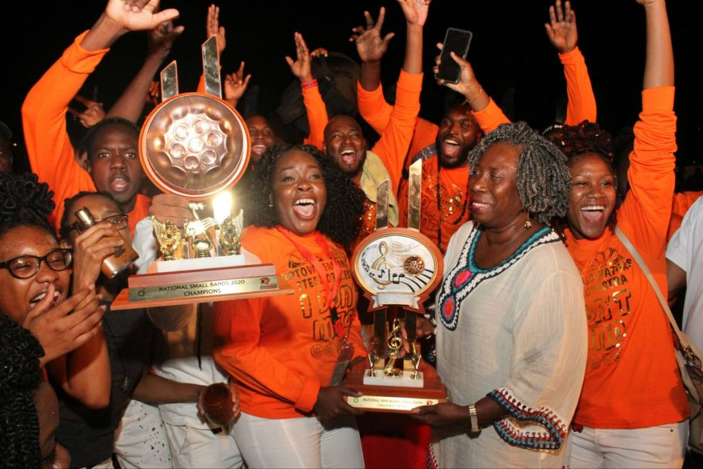 Pan Trinbago preisdent Beverley RamseyMoore, presents Uptown Fascinators Steel Orchestra with the trophy after winning the Panorama Small Bands Final at the Queen's Park Savannah, Port of Spain on Friday night. PHOTO BY ANGELO MARCELLE - Angelo Marcelle