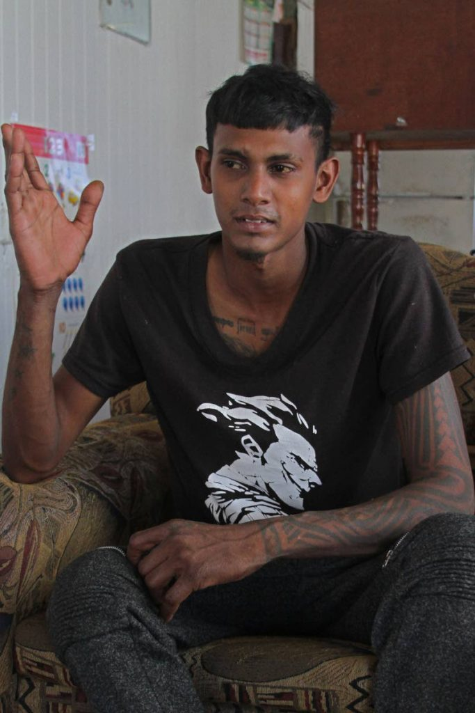 Shane Ramjattan recounts his ordeal at his Rochard Road, Penal, home, on Saturday afternoon. PHOTO BY MARVIN HAMILTON - Marvin Hamilton