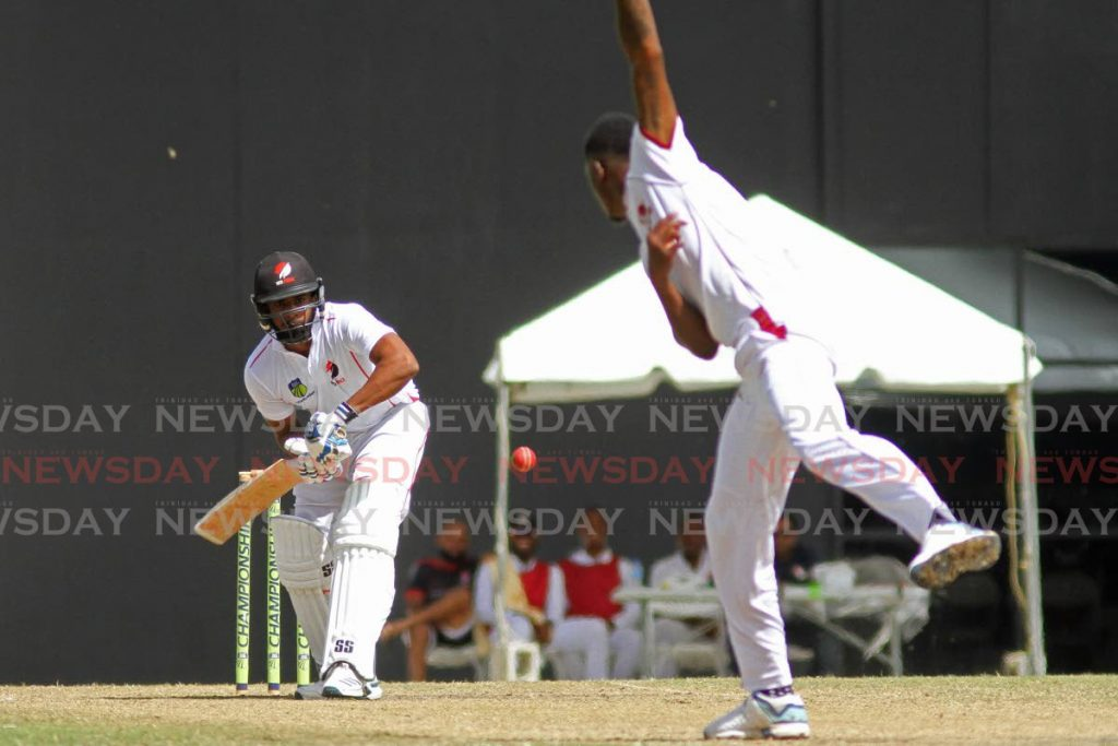 Leeward Islands Hurricanes fast bowler Alzarri Joseph bowls to TT Red Force batsman Bryan Charles in the West Indies Four-Day Championships at the Brian Lara Cricket Academy in Tarouba, on Saturday.   - Marvin Hamilton
