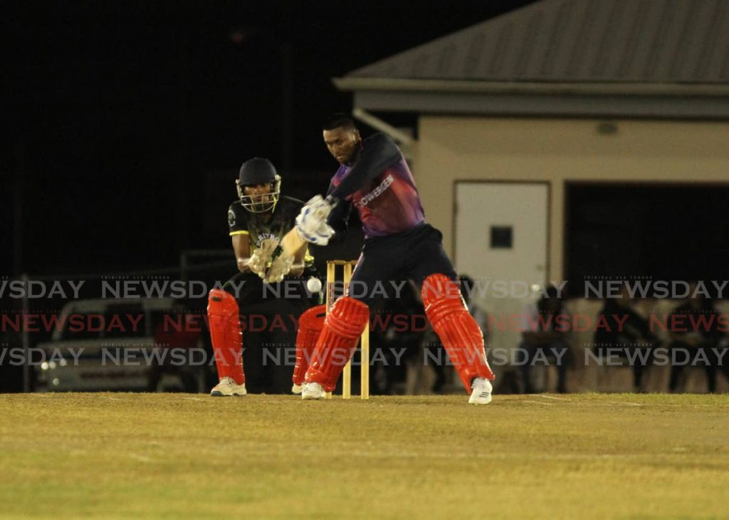 In this photo taken on Saturday, Powergen's Steven Katwaroo looks to play a shot against Merryboys, in the semi-final match, at the UWI-UNICOM T20 tournament,at the Sir Frank Worrell Grounds,St Augustine. Powergen won the title,on Sunday, in the final, against Queen's Parck Cricket Club. - Ayanna Kinsale