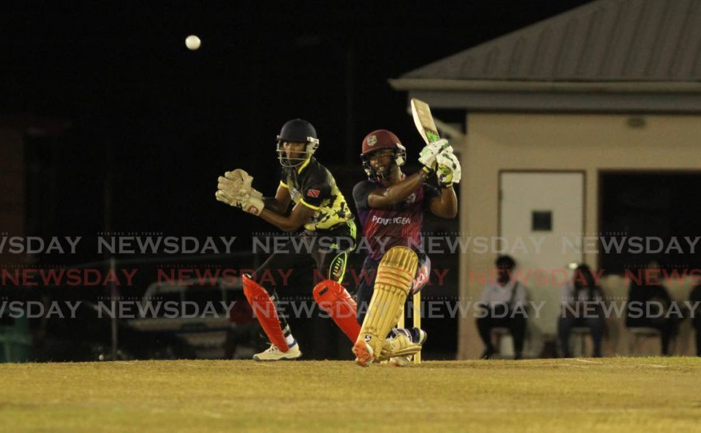 Powergen's Cephas Cooper drives powerfully through the off side against Merry Boys in the UWI-Unicom T20 Tournament semi-finals on Saturday. PHOTO BY AYANNA KINSALE  - AYANNA KINSALE