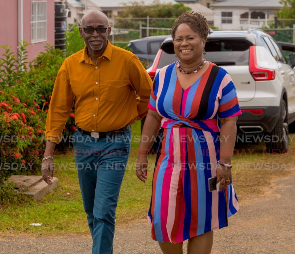 PNM leadership candidate Dr Denise Tsoiafatt Angus, right, smiles after voting with her husband Dr Dwight Angus at Signal Hill Community Centre on Sunday morning. PHOTO BY DAVID REID - DAVID REID