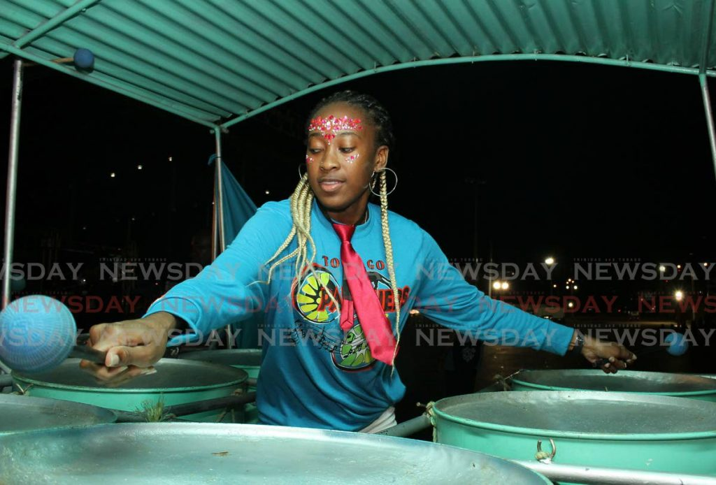 WOMAN ON THE BASS: The Tobago Pan-thers' pannist  performs Trouble In The Morning. Pan-thers tied for 13th place. - ANGELO MARCELLE