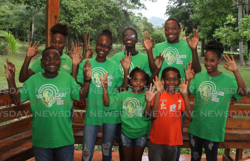 """Children say """"born free"""" in sign language at the Walker Lela Positive Film Foundation's Born Free video shoot at the Botanical Gardens on Sunday. - Ayanna Kinsale"""