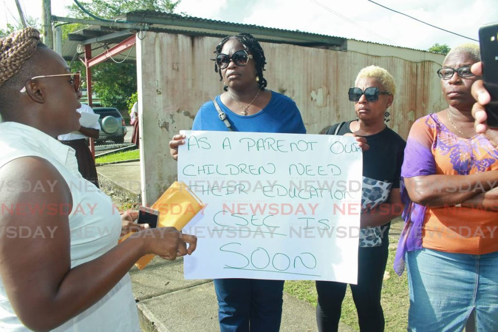 Some of the parents of students attenting the Point Fortin East Secondary School call for action from the Ministry of Education.  PHOTO BY CHEQUANA WHEELER - CHEQUANA WHEELER