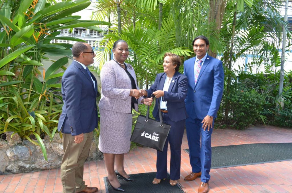 WELCOME: EMA chairman Nadra Nathai-Gyan greets Planning Minister Cherrie-Ann Crichlow-Cockburn, 2nd from left, at the EMA head office in St Clair last Thursday. At right is Ric Ali, Ag Deputy Permanent Secretary at the Planning Ministry while at left is EMA director Hayden Romano. PHOTO COURTESY EMA - EMA