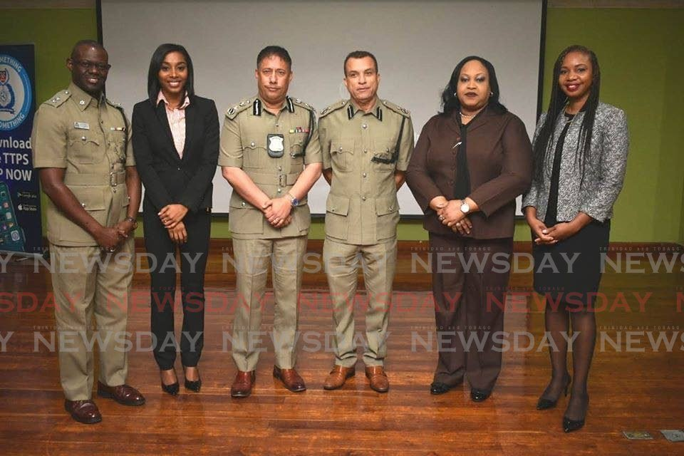 Acting Supt Benjamin of the court and process unit, left, head of the Gender Based Violence Unit (GBVU) Shireen Pollard, Police Commissioner Gary Griffith, DCP Irwin Hackshaw and representatives from the police victim and witness support unit, at the launch of the GBVU on Tuesday.  PHOTO COURTESY TTPS - Shane Superville