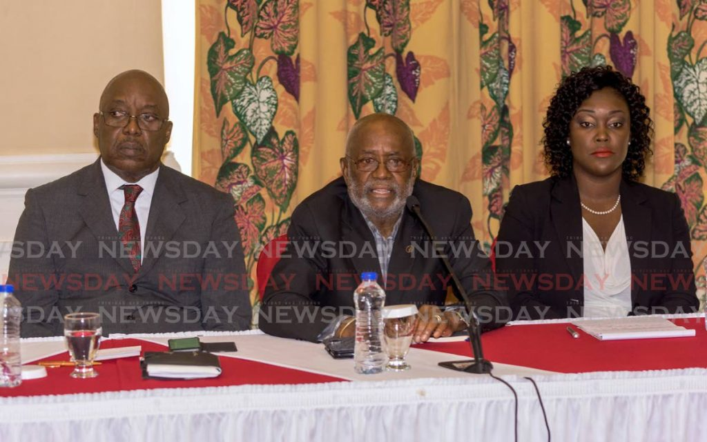 Re-elected PNM chairman Stanford Callender, centre, sits between PNM Tobago Council political leader Kelvin Charles, left, and leadership candidate Tracy Davidson-Celestine, right, at a press conference on Tuesday at the Magdalena Grand Beach and Golf Resort. PHOTO BY DAVID REID - DAVID REID