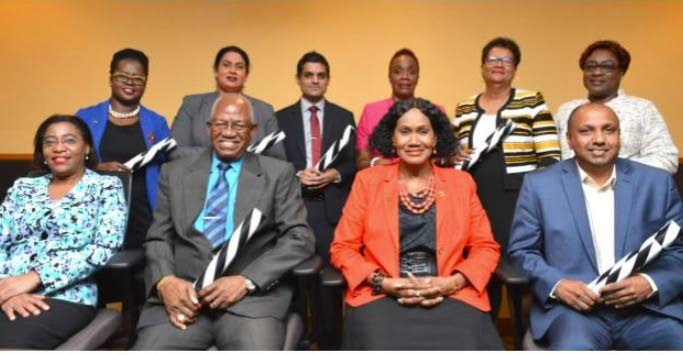 NEW BOARD: Labour Minister Jennifer Baptiste-Primus, front row 2nd from right, with from left Labour Minister Ag Permanent Secretary Natalie Willis, Nedco chairman Clarry Benn and deputy chairman Dr Mahindra Ramesh Ramdeen. Back row, from left are, Cassandra Tommy-Dabreo, Ria Ramdeen, Nigel Bhagwatsaran, Joann Felix, Willa Guy-Straker and Marjorie Moore-Carrington. PHOTO COURTESY MINISTRY OF LABOUR - Ministry of Labour