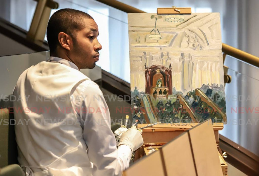 Artist Antonio Figuero does a painting of the Red House chamber during the re-opening of the historic building as the seat of Parliament on Friday.  PHOTO BY JEFF K MAYERS - JEFF K MAYERS