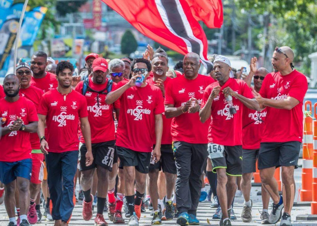 TT Olympic Committee (TTOC) president Brian Lewis, middle, walks the TT International Marathon with supporters, on Sunday.  - Melanie Gulston/TTOC