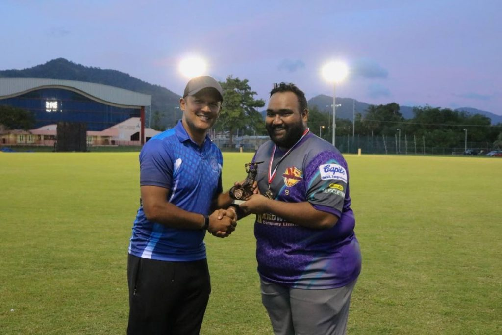 Arun Pandohie, right, collects the player of the match award from Naparima Blues skipper Daren Ganga for his spell of 2/15 at the Richard Kokaram Memorial Match at the Sir Frank Worrell Ground, University of the West Indies, St Augustine.   -