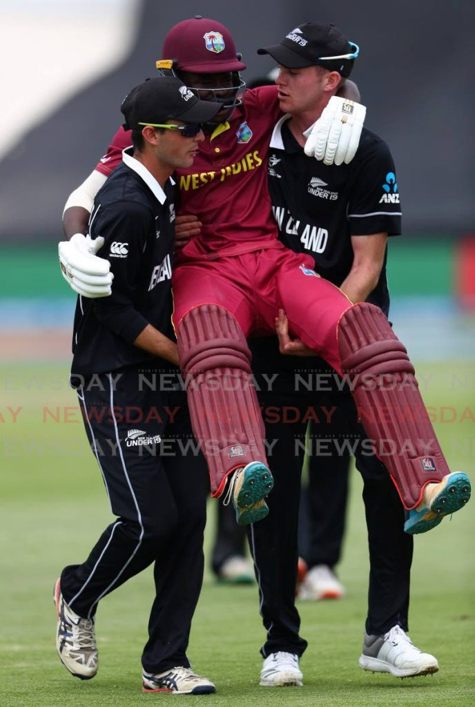 West Indies under 19 player Kirk McKenzie is carried off the field by two New Zealand players. - Matthew Lewis-ICC