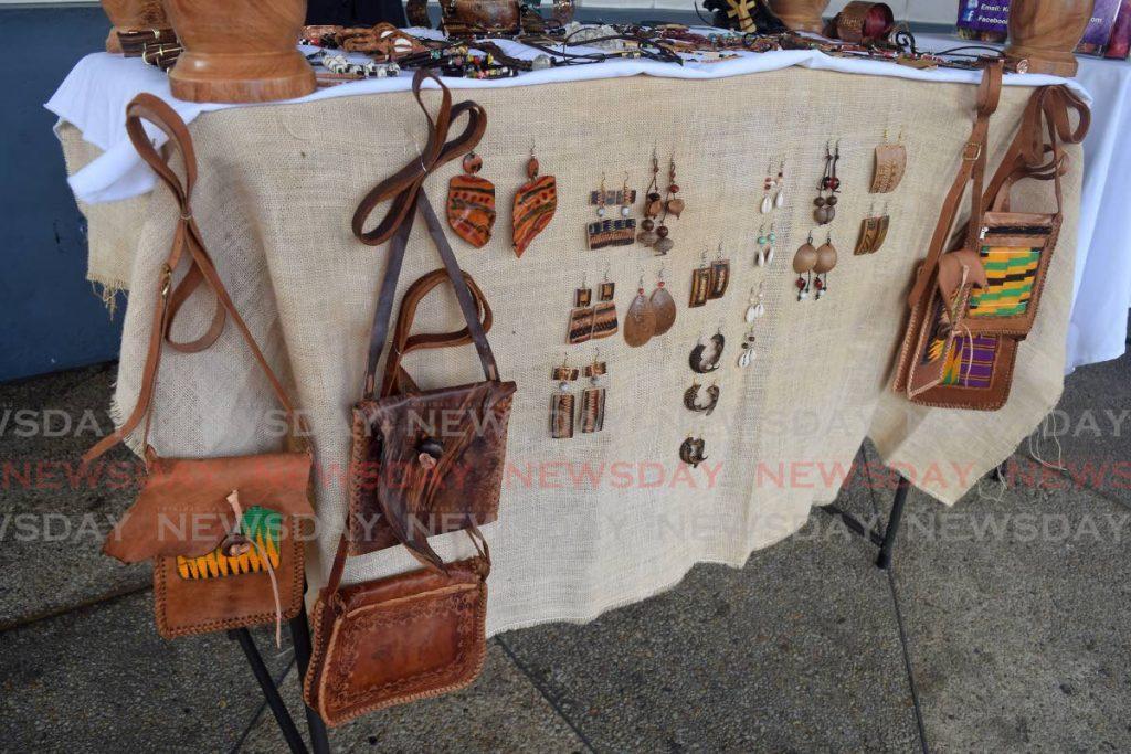 Leather purses and jewellery. - Vidya Thurab