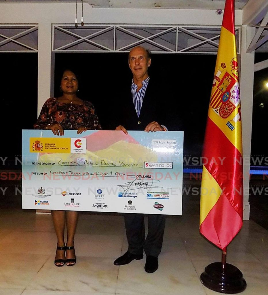 General manager of CADV Sabrina Mowlah-Baksh, left, receives a cheque from the Ambassador of Spain Javier Carbajosa on Wednesday.  - Shane Superville