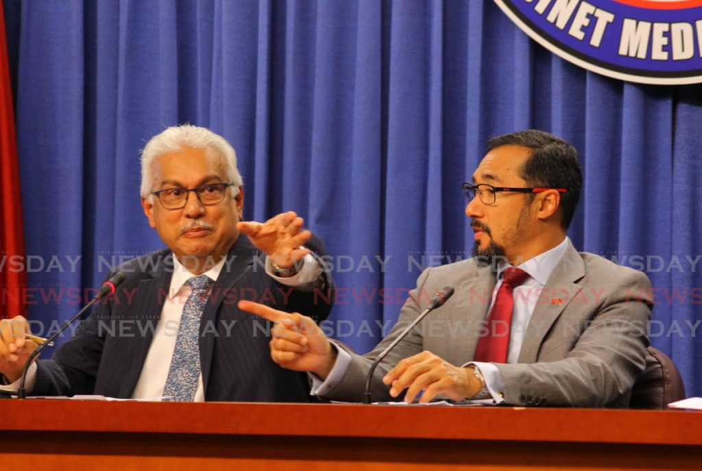 Minister of National Security Stuart Young, right,  and Minister of Health Terrence Deyalsingh at a post cabinet media conference at the Diplomatic Centre in St Ann's, Port of Spain, on Thursday. - ROGER JACOB