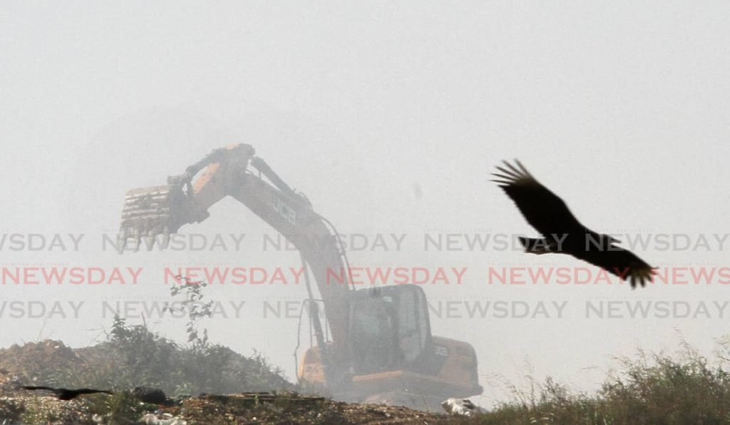 Heavy machinery is being used to fight a fire at the Guanapo Landfill in Arima on Thursday.  Residents of Arima and environs say smoke from the landfill has been affecting them since Wednesday.  - Angelo Marcel