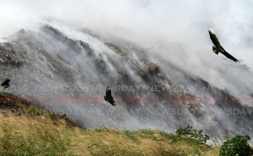 Smoke billows out of the Guanapo Landfill in Arima as it burns on Thursday.  Residents of Arima and environs say smoke from the landfill has been affecting them since Wednesday.  - Angelo Marcelle
