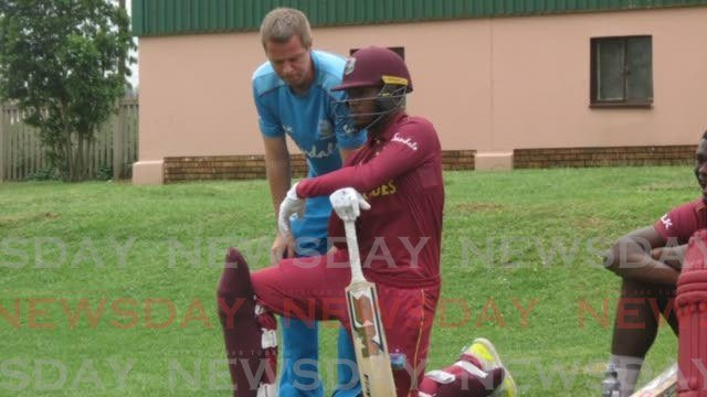 West Indies U19 cricketer Jayden Seales, of TT, listens to coach Graeme West during an ICC U19 World Cup match recently.  - CWI Media