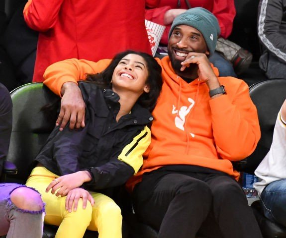 Kobe Bryant and daughter Gianna Bryant attend a basketball game between the Los Angeles Lakers and the Dallas Mavericks at Staples Center on December 29, 2019 in Los Angeles, California.