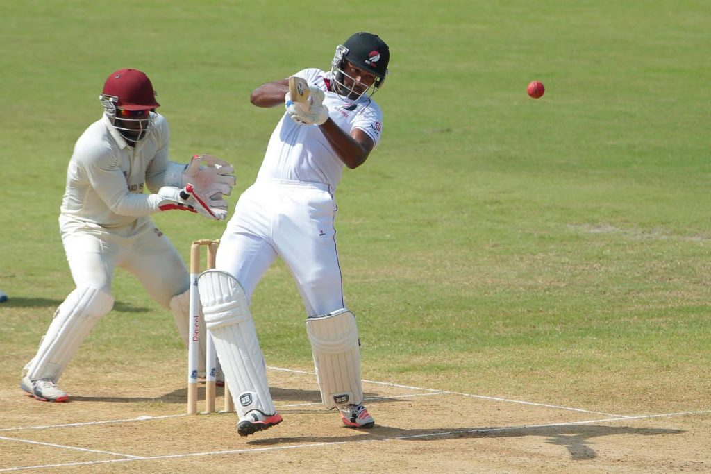 Jyd Goolie (right) in action for TT Red Force against the Leeward Islands Hurricanes during a recent match. -