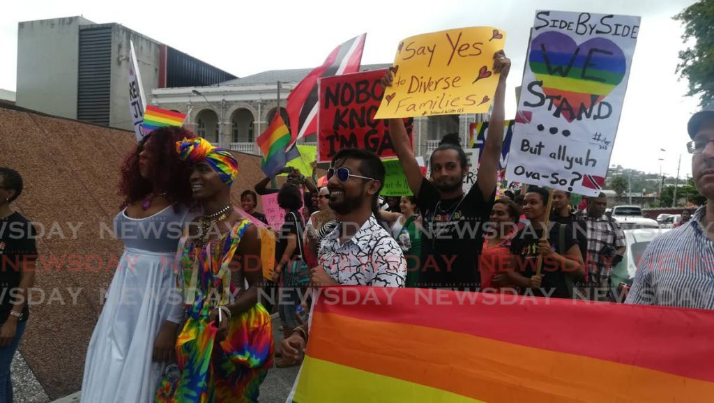 In this April 2018 file photo, LGBTQI protesters stand near the Hall of Justice, Port of Spain during a hearing on the constitutionality of TT's buggery law. In September, that year, a judge amended the laws to make consensual sex in same-sex unions legal. -