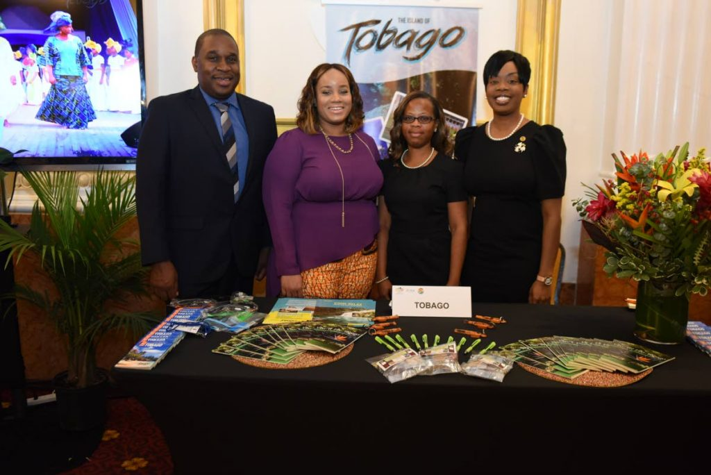 Tobago Tourism Agency Ltd CEO Louis Lewis, left, Tourism Secretary Nadine Stewart-Phillips, right, and members of the Tobago delegation, Sheena Des Vignes and Denise Doyle-Sebro, at Tobago's booth at the Trade Show, Educational Forum and Dinner for Travel Agents during Caribbean Week 2018, hosted by the Caribbean Tourism Organisation in New York. -