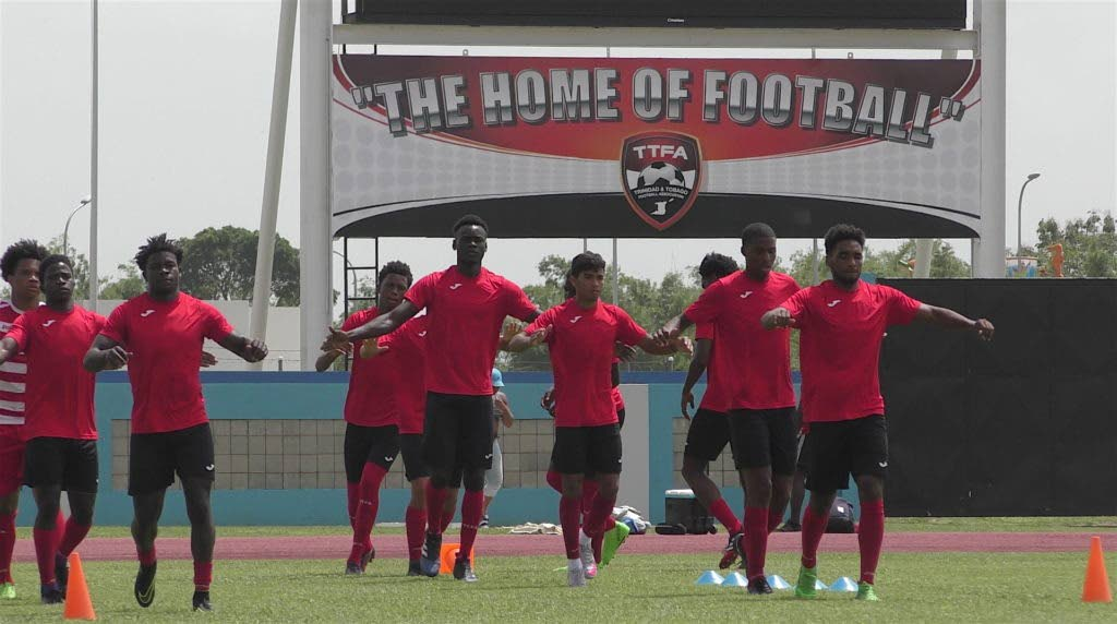 In this file photo, members of the National Under 20 football team train at the Ato Boldon Stadium in Couva.  -