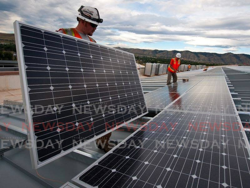 Solar panel being installed. Karen Darbasie, CEO of First Citizens Bank says while the financial sector may be willing to partner with companies on developing renewable energy projects, there are barriers. Photo taken from solarexmagazine.com -
