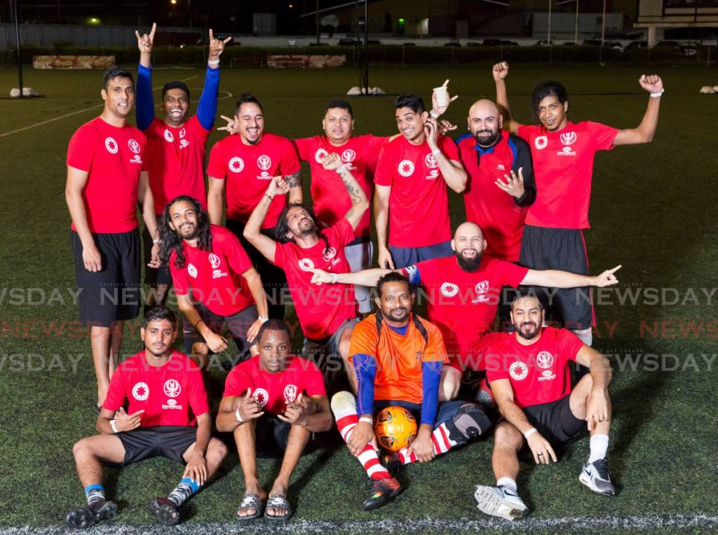 Rockers Cup winners show off their Support Autism T&T T-shirts. The Rockers Cup has donated $7,000 to the charity. -