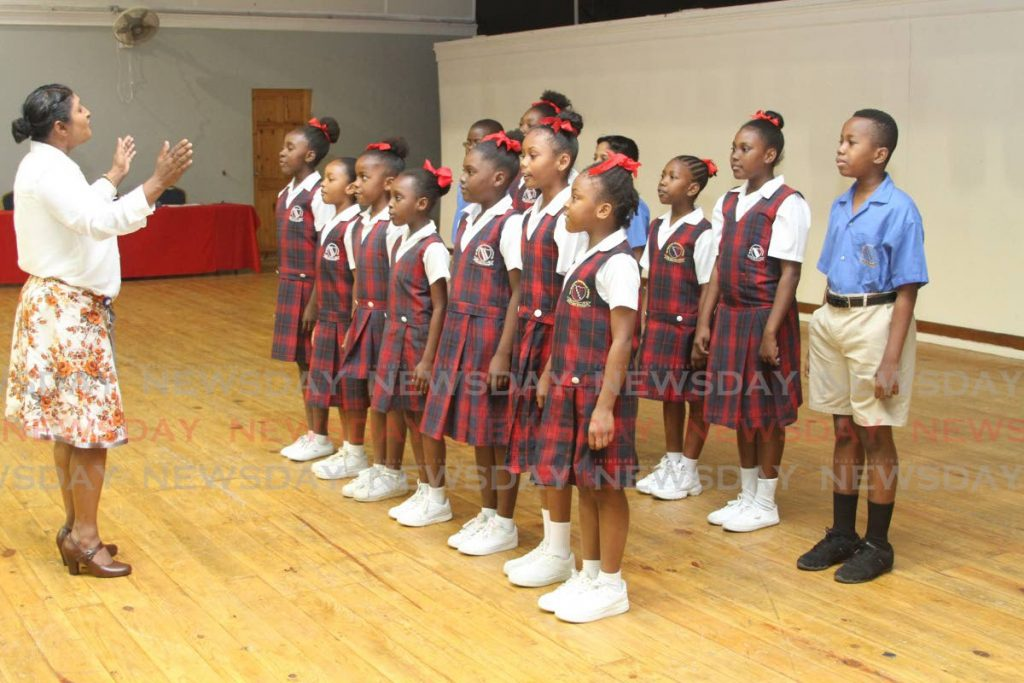 Pupils of Ste Madeleine Government Primary School sing at the launch of children's illustrated song book Patriotism and the City of San Fernando at the Naparima College, San Fernando. - Marvin Hamilton