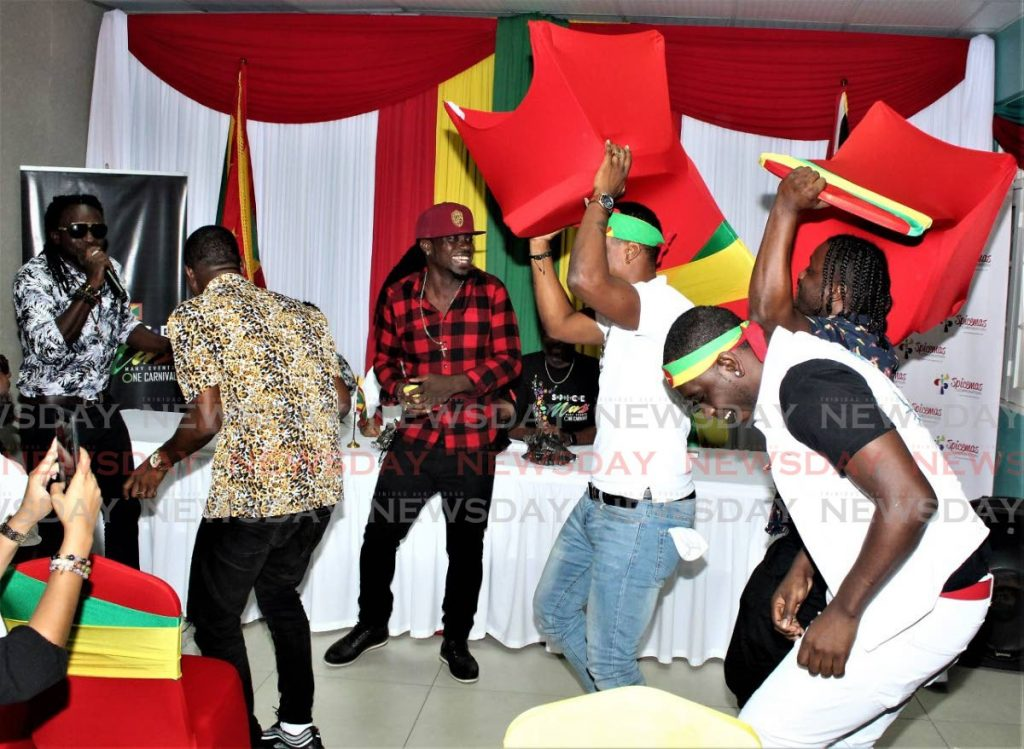 Several  artistes enact Mr Killa's song at the Grenada Counsulate office on Henry Street, Port of Spain at the cosnsulate's Meet Our Artistes even on Friday. - Gary Cardinez