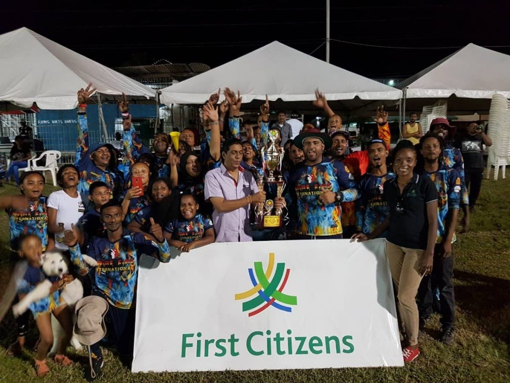 More Fire collects their trophy from league organisers and First Citizens officials at the closing ceremony of the First Citizens Norman's Windball 12-over Cricket League Finals at Macoya Gardens, last Sunday. -
