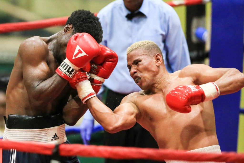 Super Heavy Weight Pro-Cuba's Eduardo Medina (right) lands an upercut against Akil Outram, during the Spanish Invasion Boxing Championships between bout, at the Plesantville Indoor Sports Arena. -  Allan V. Crane/CA-images