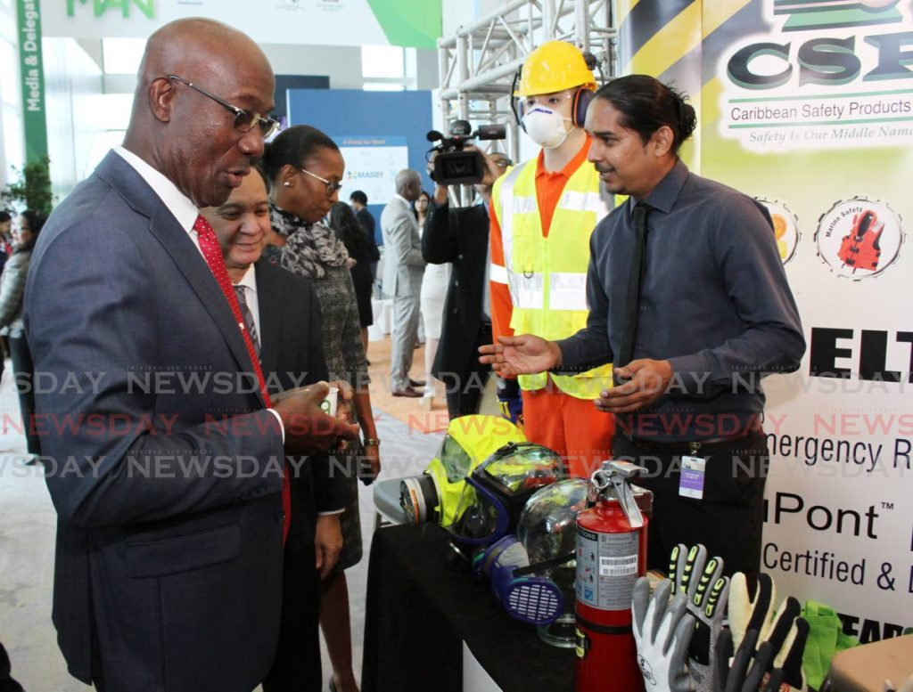 Prime Minister Dr Keith Rowley, Energy Minister Franklin Khan and La Brea MP Nicole Nicole Olivierre, look at safety equipment from Caribbean Safety Products at the TT Energy Conference 2020 at Hyatt Regency, Port of Spain on Monday.      - ANGELO_MARCELLE