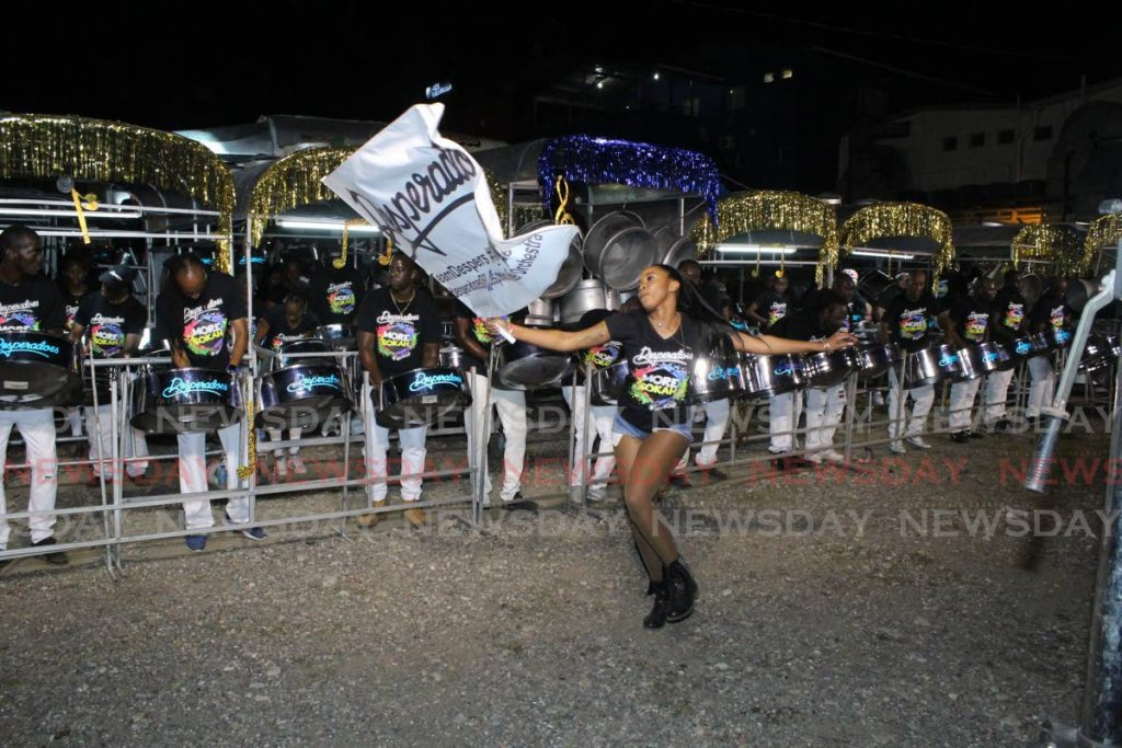 This flag woman kept the tempo going for the Desperadoes steel orchestra at Tragarete Road. - GARY CARDINEZ