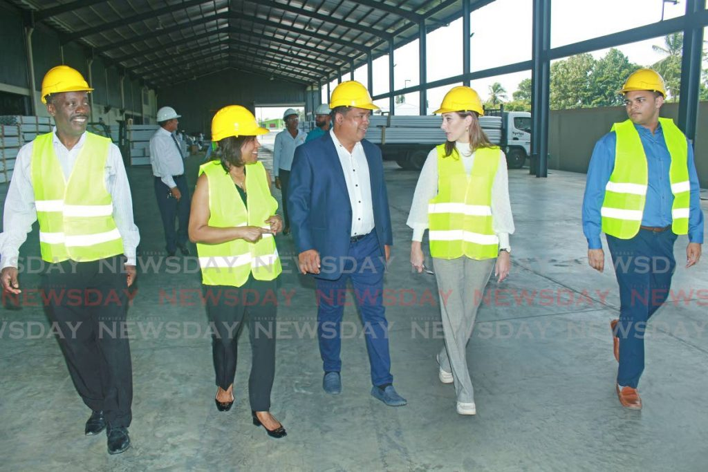 Left to right, Ministry of Trade and Industry PS Norris Herbert, Minister Paula Gopee-Scoon, New Wave Marketing managing director Jaio Ramkissoon, TTMA president Franka Costelloe and head of procurement and business relations at New Wave Marketing Emil Ramkissoon during a tour of the company in Couva. - CHEQUANA WHEELER
