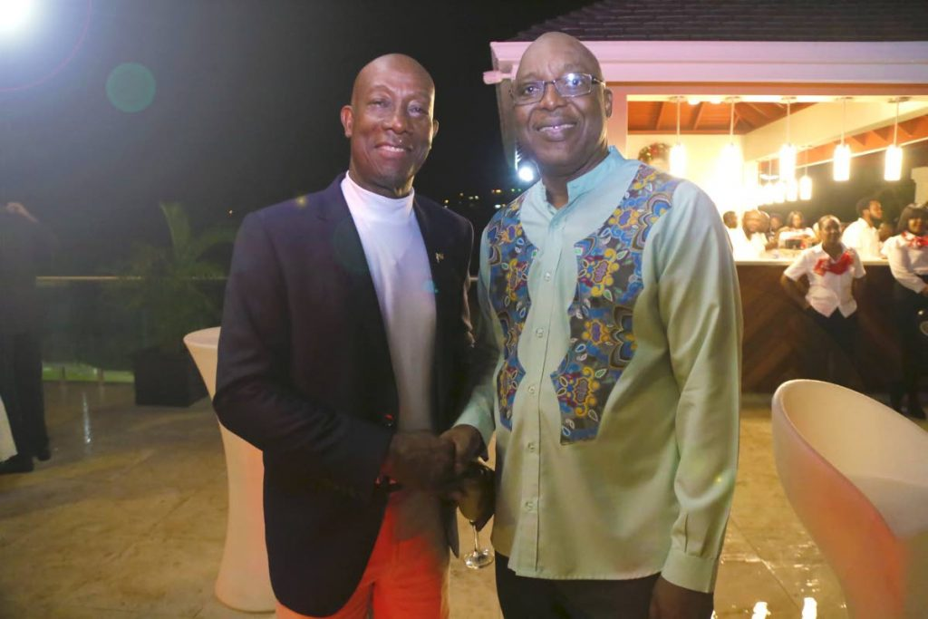 Prime Minister Dr Keith Rowley, left, greets Chief Secretary Kelvin Charles at the opening of the PM residence in Blenheim on December 21, 2019. PHOTO COURTESY Office of the Chief Secretary  - Office of the Chief Secretary