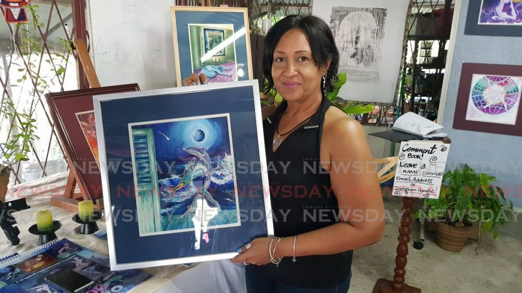 Allison Mykoo with one of her pieces on display at the SerendipiTea 4 at her Palmiste home.  -