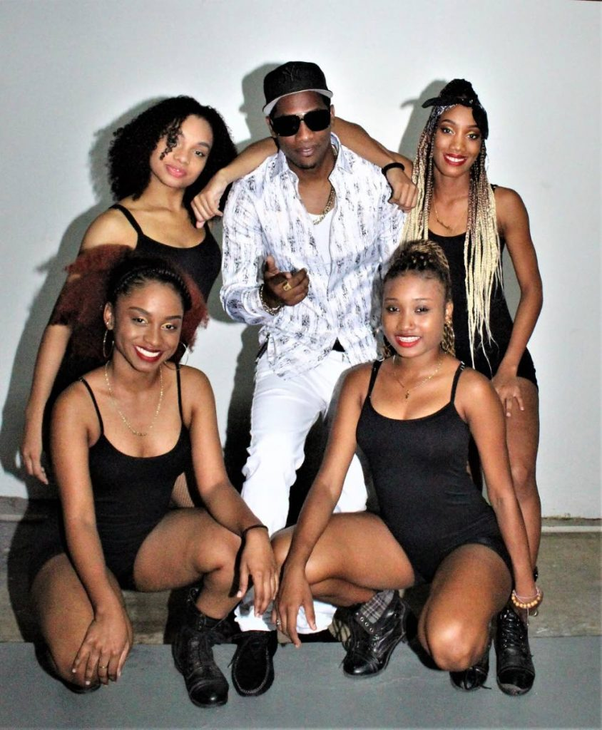 Ricardo Ricochae James pose with XO Dancers before one of his performances. -