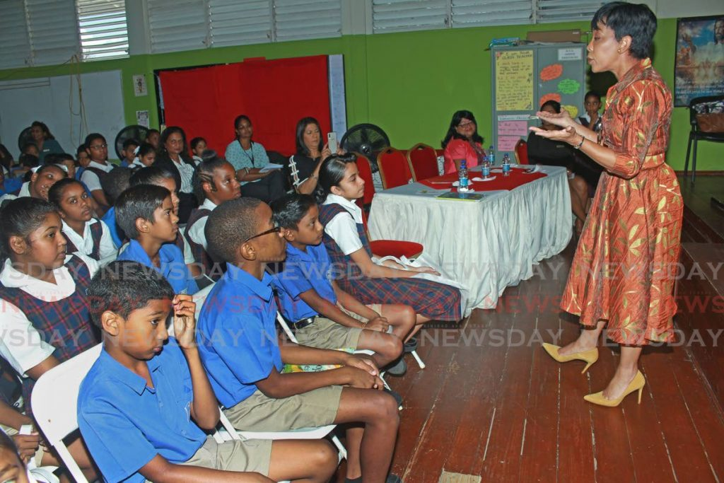 Sharon Rowley speaks to students of the Hermitage Presbyterian Primary School in San Fernando about the importance of reading.  PHOTO BY CHEQUANA WHEELER - CHEQUANA WHEELER