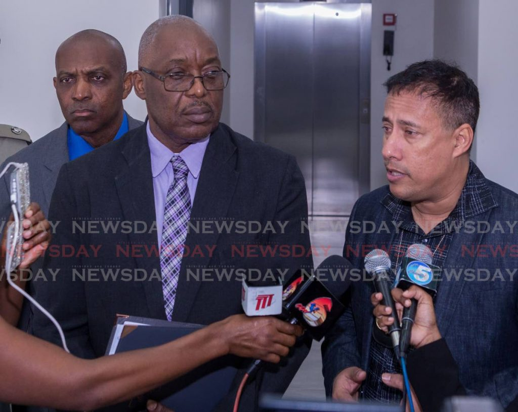 Commissioner of Police Gary Griffith, right, talks to the media after meeting with Chief Secretary Kelvin Charles, left, and the Business Chamber last week.  - DAVID REID