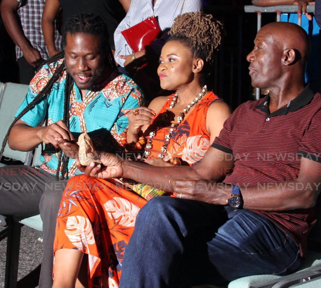 HAVE SOME NUTS: PM Dr Keith Rowley shares some nuts with Laventille East / Morvant MP Adrian Leonce at the CAL Skiffle panyard. - Vashti Singh