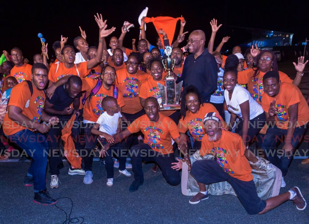 SWEET VICTORY: Katzenjammers Steel Orchestra members celebrate reclaiming the large band title at THA Pan Champs on Wednesday evening at Parade Grounds, Bacolet. PHOTO BY DAVID REID  - DAVID REID