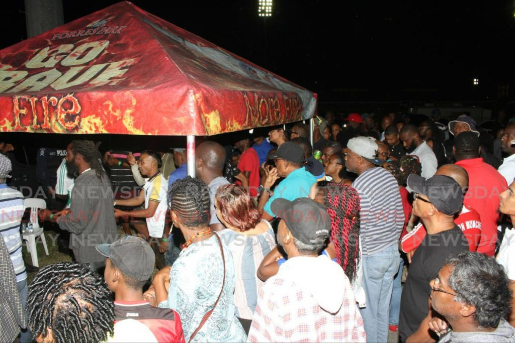 Patrons crowd the entrance hoping to be refunded for a cancelled stickfighting semifinal round at the Arima Velodrome on Friday night. Photo by  ANGELO MARCELLE - Angelo Marcelle