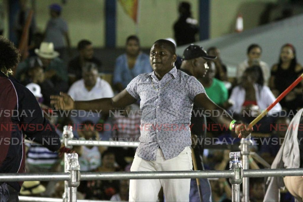 A stickfighter warms up in the gayelle for the semifinals of the 2020 National Stickfighting Competition at Arima Velodrome on Friday. A protest over appearance fees and prizes led to the NCC to cancel the event and the entire competition.  - ANGELO MARCELLE - Angelo Marcelle