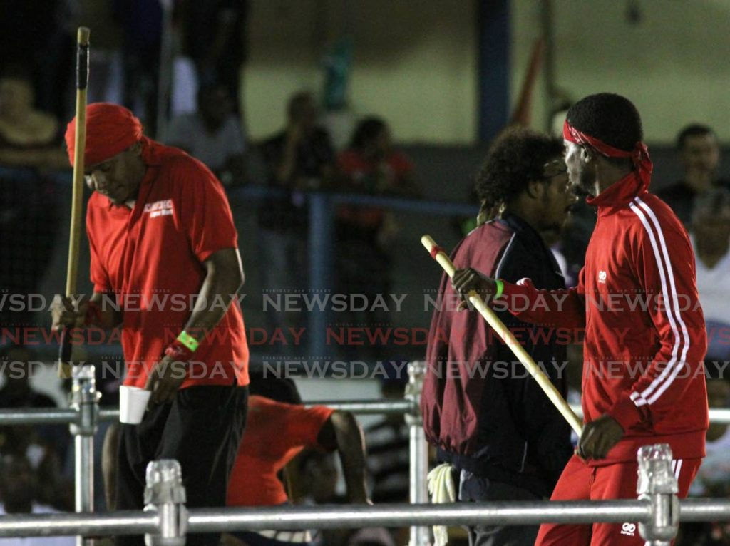 Stick fighters gather on stage awaiting word on whether they will be paid on Friday in Arima. PHOTO BY ANGELO MARCELLE - Angelo Marcel