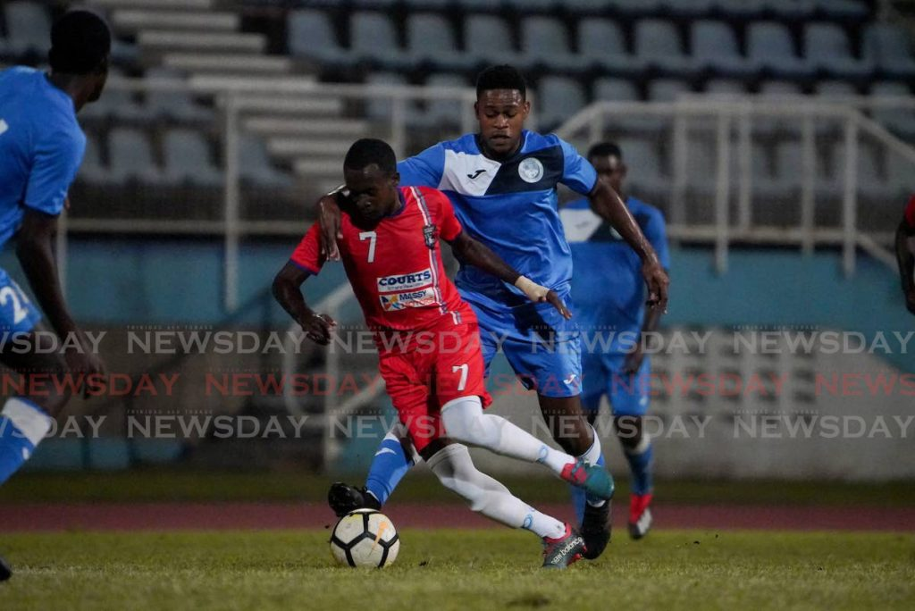 Police FC J'deem Parris (R) duels Morvant/Caledonia's Parnell Schultz for the ball during the TT Pro League match between Morvant/Caledonia United and Police FC at the Ato Boldon Stadium, Couva. The game ended 2-2.   -  Daniel Prentice/CA-Images