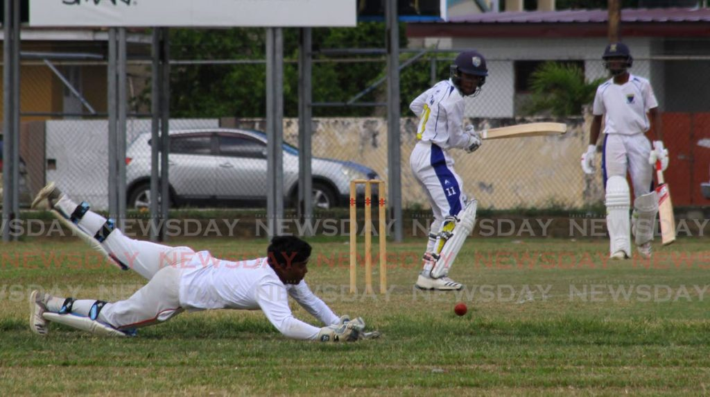 Wicket-keeper Rahul Pitiram of Presentation College, Chaguanas dives for the ball in a PowerGen Secondary Schools Cricket League Premiership Division match against Fatima College at the latter's school ground in Port of Spain, on Tuesday.  - ROGER JACOB